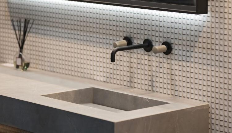 Bathroom interior grey marble sink and black tap. Beautiful modern bathroom design